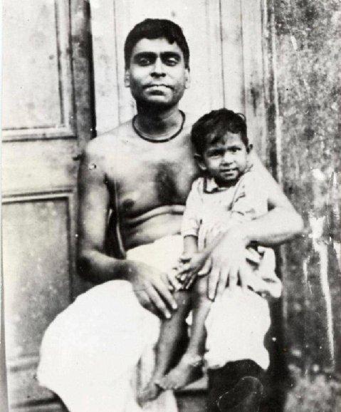 Srila Bhaktivinoda holding young Bhaktisiddhanta