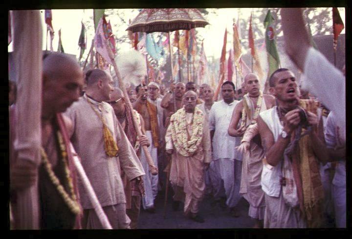 Srila Prabhupada with unbrella etc.