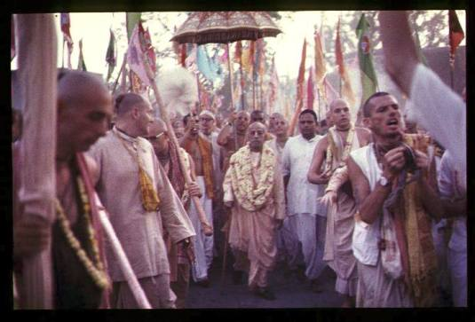 Srila Prabhupada with unbrella etc.